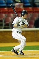 Conor Keniry #14 of the Wake Forest Demon Deacons follows through on his swing against the North Carolina Tar Heels at Gene Hooks Field on March 11, 2011 in Winston-Salem, North Carolina.  Photo by Brian Westerholt / Four Seam Images