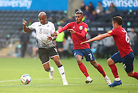 17th October 2020; Liberty Stadium, Swansea, Glamorgan, Wales; English Football League Championship Football, Swansea City versus Huddersfield Town; Andre Ayew of Swansea City is challenged by Juninho Bacuna of Huddersfield Town