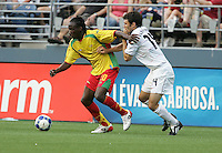 Jake Rennie (20) tries to push off Michael Parkhurst (14). USA defeated Grenada 4-0 during the First Round of the 2009 CONCACAF Gold Cup at Qwest Field in Seattle, Washington on July 4, 2009.