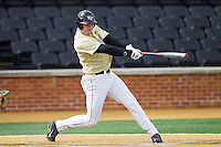 Matt Conway (25) of the Wake Forest Demon Deacons follows through on his swing against the Marshall Thundering Herd at Wake Forest Baseball Park on February 17, 2014 in Winston-Salem, North Carolina.  The Demon Deacons defeated the Thundering Herd 4-3.  (Brian Westerholt/Four Seam Images)