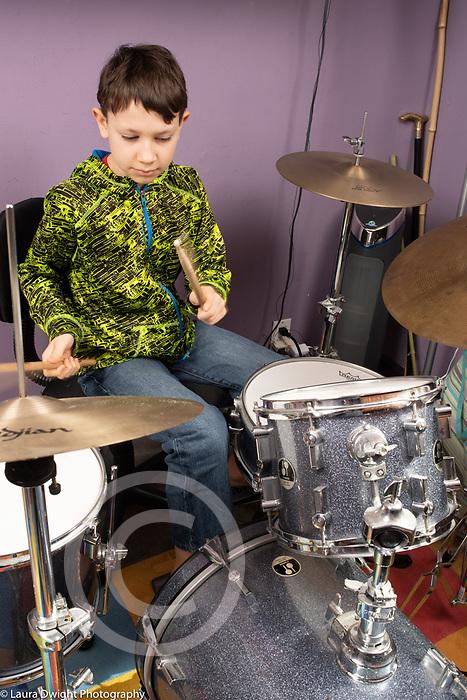 11 year old boy playing drum set