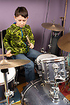 11 year old boy playing drum set