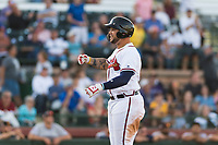 Peoria Javelinas first baseman Braxton Davidson (34), of the Atlanta Braves organization, pounds his chest while looking at the dugout after hitting a walk-off home run to win the Arizona Fall League Championship Game against the Salt River Rafters at Scottsdale Stadium on November 17, 2018 in Scottsdale, Arizona. Peoria defeated Salt River 3-2 in 10 innings. (Zachary Lucy/Four Seam Images)