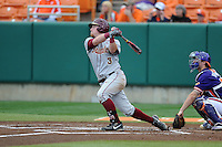 Florida State Seminoles first baseman John Nogowski #3 swings at a pitch during a game against the Clemson Tigers at Doug Kingsmore Stadium on March 22, 2014 in Clemson, South Carolina. The Seminoles defeated the Tigers 4-3. (Tony Farlow/Four Seam Images)