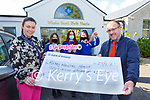 Teacher  Sheree Murphy presents the proceeds of the St Brigids Presentation school Tie Day Friday fundraiser in aid of the Kerry Mental Health Association  to John Drummy on Friday with students l-r Amy Leahy, Kadie McCannon Emer Cronin