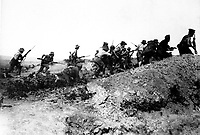 Scene just before the evacuation at Anzac.  Australian troops charging near a Turkish trench.  When they got there the Turks had flown.  Dardanelles Campaign, ca.  1915 British Official. (War Dept.)<br /> Exact Date Shot Unknown<br /> NARA FILE #:  165-BO-590<br /> WAR & CONFLICT BOOK #:  636