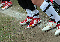 COLLEGE PARK, MD - OCTOBER 28, 2012:  Players of the University of Maryland wear special Maryland State flag cleats during an ACC  women's tournament 1st. round match against Miami at Ludwig Field in College Park, MD. on October 28. Maryland won 2-1 on a golden goal in extra time.