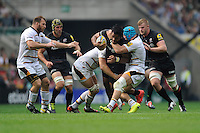 Billy Vunipola of Saracens is tackled by James Haskell of Wasps during the Premiership Rugby Round 1 match between Saracens and Wasps at Twickenham Stadium on Saturday 6th September 2014 (Photo by Rob Munro)