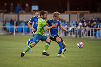 SAN JOSE, CA - MAY 12: Joao Paulo  #6 of the Seattle Sounders challenges Jackson Yueill #14 of the San Jose Earthquakes for the ball during a game between San Jose Earthquakes and Seattle Sounders FC at PayPal Park on May 12, 2021 in San Jose, California.