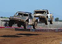 Apr 16, 2011; Surprise, AZ USA; LOORRS driver Steve Barlow (83) leads Josh Merrell (22) during round 3 at Speedworld Off Road Park. Mandatory Credit: Mark J. Rebilas-.