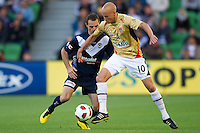 MELBOURNE, AUSTRALIA - DECEMBER 27: Tom Pondeljak of the Victory and Ruben Zadkovich of the Jets contest the ball during the round 20 A-League match between the Melbourne Victory and the Newcastle Jets at AAMI Park on December 27, 2010 in Melbourne, Australia. (Photo by Sydney Low / Asterisk Images)