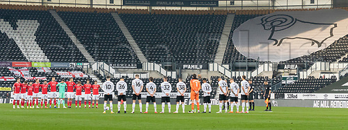 7th November 2020; Pride Park, Derby, East Midlands; English Football League Championship Football, Derby County versus Barnsley; Derby County and Barnsley players along with match officials stand silent on the centre circle prior to the kick off to pay their respects as part of Remembrance Sunday on 8th November 2020