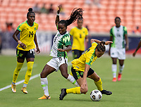 HOUSTON, TX - JUNE 10: Toni Payne #9 of Nigeria is defended by Chinyelu Asher #17 of Jamaica during a game between Nigeria and Jamaica at BBVA Stadium on June 10, 2021 in Houston, Texas.