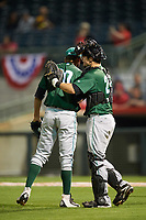 Daytona Tortugas catcher Chris Okey (25) congratulates relief pitcher Geoff Broussard (20) after closing out a game against the Florida Fire Frogs on April 6, 2017 at Osceola County Stadium in Kissimmee, Florida.  Daytona defeated Florida 3-1.  (Mike Janes/Four Seam Images)