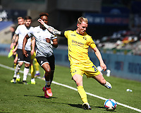 17th April 2021; Liberty Stadium, Swansea, Glamorgan, Wales; English Football League Championship Football, Swansea City versus Wycombe Wanderers; Jack Grimmer of Wycombe Wanderers clears the ball whilst under pressure