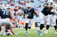 CHAPEL HILL, NC - OCTOBER 10: Michael Carter #8 of North Carolina scores a touchdown on a 16-yard run during a game between Virginia Tech and North Carolina at Kenan Memorial Stadium on October 10, 2020 in Chapel Hill, North Carolina.