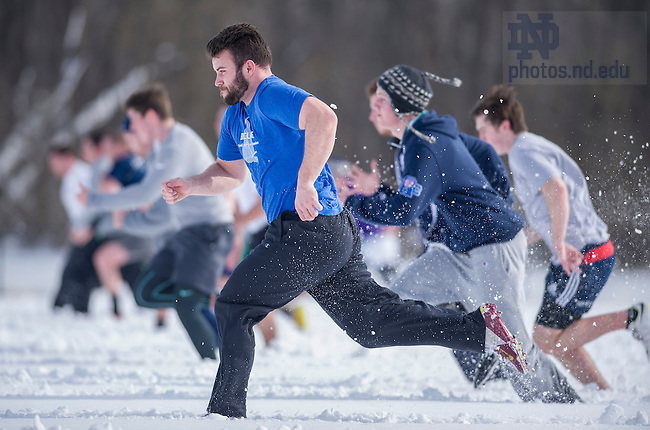 Feb. 7, 2015; Members of the Notre Dame Rugby team run laps in the snow on Stinson Rugby Field. The players were preparing for their game next week in the Collegiate Division of the USA 7s Tournament held in Las Vegas. It's the largest rugby tournament in the US. (Photo by Barbara Johnston/University of Notre Dame)