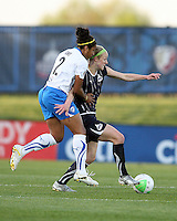 Becky Sauerbrunn#22 of the Washington Freedom is held back by Chioma Igwe#2 of the Boston Breakers during a WPS match on April 10 2010, at the Maryland Soccerplex, in Boyds, Maryland.