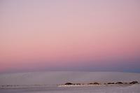 The sun sets at White Sands National Monument near Alamogordo, New Mexico, USA, on Fri., Dec. 29, 2017.
