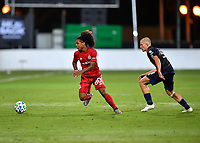 LAKE BUENA VISTA, FL - JULY 26: Jayden Nelson of Toronto FC dribbles away from Alexander Ring of New York City FC during a game between New York City FC and Toronto FC at ESPN Wide World of Sports on July 26, 2020 in Lake Buena Vista, Florida.