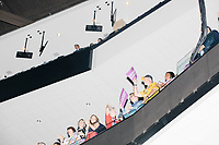 People listen from the stands during a speech at the Democratic National Convention at the Wells Fargo Center in Philadelphia, Pennsylvania, on Wed., July 27, 2016.
