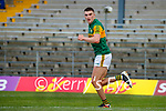 Seán O'Shea, scores Kerry's first goal despite the attention of Cillian Brennan, Clare, during the Munster Football Championship game between Kerry and Clare at Fitzgerald Stadium, Killarney on Saturday.