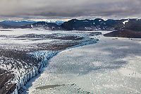 Aerial of the terminus of Bering glacier as it meets Berg lake in the Chugach mountains, southcentral, Alaska.