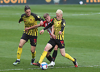 Will Hughes of Watford tries to shake of a challenge from Brentford's Marcus Forss during Brentford vs Watford, Sky Bet EFL Championship Football at the Brentford Community Stadium on 1st May 2021