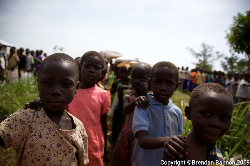 Refugee children wait in line for school to begin. More than 300 children are in each class..