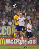 Sweden defender Linda Sembrant (4) and US forward Lauren Cheney (12) battle for head ball. The US Women's national team beat Sweden, 3-0, at Rentschler Field on July 17, 2010.