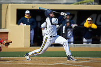 Ben Gibson (30) of the Quinnipiac Bobcats follows through on his swing against the Radford Highlanders at David F. Couch Ballpark on March 4, 2017 in Winston-Salem, North Carolina. The Highlanders defeated the Bobcats 4-0. (Brian Westerholt/Four Seam Images)
