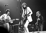 Eric Clapton 1973  Rainbow Theatre In London in 70's here with Ron Wood and Ric Grech<br /> © Chris Walter