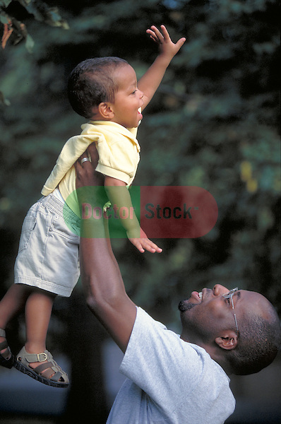 young father playing with young child