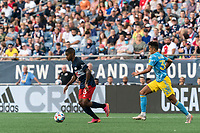 FOXBOROUGH, MA - AUGUST 8: Maciel #13 of New England Revolution dribbles as Quinn Sullivan #33 of Philadelphia Union closes during a game between Philadelphia Union and New England Revolution at Gillette Stadium on August 8, 2021 in Foxborough, Massachusetts.
