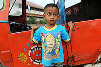 A young Indonesian bit in a slum community in central Jakarta. It is estimated over 25% of Indonesians live in slum areas, with more than 5 million people living in slum areas in the greater Jakarta area.