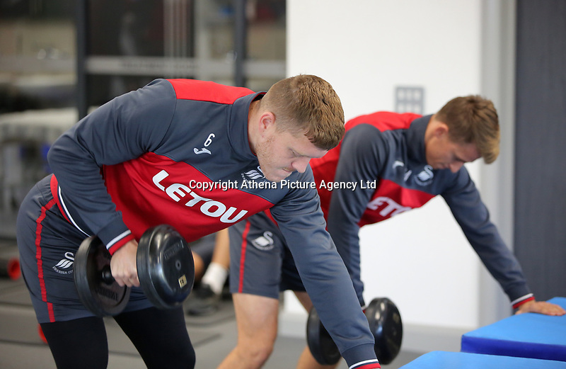 (L-R) Alfie Mawson and Tom Carroll exercise in the gym during the Swansea City Training at The Fairwood Training Ground, Swansea, Wales, UK. Wednesday 01 November 2017