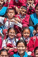 Bhaktapur, Nepal.  Schoolchildren Sitting on Steps of Nyatapola temple.