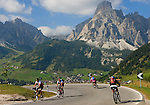 Italy, South Tyrol, Alto Adige, Dolomites, Corvara in Badia and Colfosco in Badia with Puez mountains, cyclists