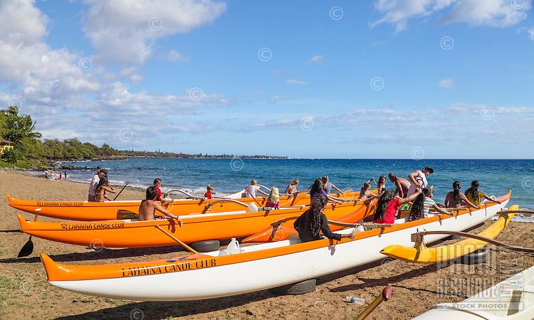 Canoe paddling practice teams with their outrigger canoes at Hanakao'o Beach Park (a.k.a. Canoe Beach), Lahaina, Maui.