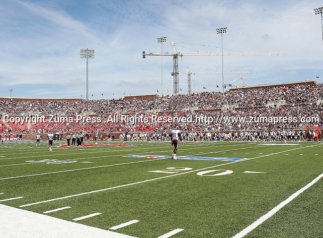 Southern Methodist Mustangs and the Texas A&M Aggies get ready to start the game between the Southern Methodist Mustangs and the Texas A&M Aggies at the Gerald J. Ford Stadium in Dallas, Texas. Texas A & M defeats SMU 48 to 3.