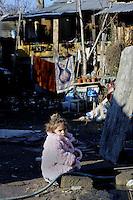 Roma 22 Gennaio 2010.Campo Rom Casilino 900.Abbattimento delle baracche.Chiude il campo rom di Casilino 900..Ultimi giorni , le poche famiglie rimaste preparano le poche cose da portare via..Demolition of shacks.Closes the field of Roma Casilino 900..Last days, the few remaining families prepare to take away the few things and clean.Demolition of shacks.Closes the field of Roma Casilino 900..Last days, the few remaining families prepare to take away the few things