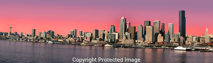 The downtown Seattle, Washington skyline is anchored by the Space Needle to the north and ferry docks on the south end.