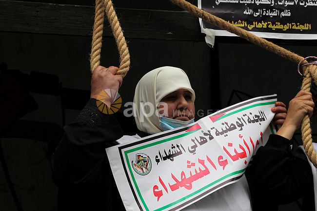 """Families of Palestinian martyrs and wounded, take part in a protest tent against the Palestinian Authority's decision to cut their salaries for seven years, in Gaza city, on March 23, 2021. """"The leaders agreed on the solutions for the outstanding issues in a bid to guarantee high transparency and integrity for the electoral process in the Palestinian territories,"""" it said. Photo by Mahmoud Ajjour"""