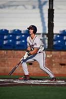 Danville Braves third baseman Brett Langhorne (23) follows through on a swing during a game against the Johnson City Cardinals on July 29, 2018 at TVA Credit Union Ballpark in Johnson City, Tennessee.  Johnson City defeated Danville 8-1.  (Mike Janes/Four Seam Images)