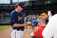 Montgomery Biscuits pitcher Matt Krook (31) signs autographs for fans before a game against the Biloxi Shuckers on May 8, 2018 at Montgomery Riverwalk Stadium in Montgomery, Alabama.  Montgomery defeated Biloxi 10-5.  (Mike Janes/Four Seam Images)
