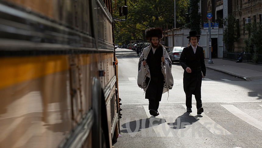 NEW YORK, NEW YORK - OCTOBER 10: Residents walk by a synagogue in the Brooklyn neighborhood of Borough Park on October 10, 2020 in Brooklyn New York. Brooklyn federal judge ruled in a lawsuit filed by several Jewish organizations after Gov. Andrew M. Cuomo has placed restrictions on gatherings at synagogues and other houses of worships (Photo by Kena Betancur/VIEWpress via GettyImages)
