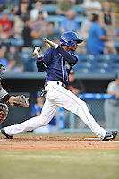 Asheville Tourists left fielder Raimel Tapia #15 swings at a pitch during opening night game against the Delmarva Shorebirds at McCormick Field on April 3, 2014 in Asheville, North Carolina. The Tourists defeated the Shorebirds 8-3. (Tony Farlow/Four Seam Images)