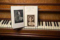 BNPS.co.uk (01202) 558833<br /> Pic: ZacharyCulpin/BNPS<br /> <br /> Pictured: Other covetable instruments include a ship's piano with folding keyboard, purchased by the RAF WWI Flying ace Captain Norman Macmillan (left) for his wife, the Music Hall singer, Ena Beaumont (right)<br /> <br /> A remarkable collection of rare pianos belonging to the Queen's personal restorer and conservator has emerged for sale for £250,000.<br /> <br /> David Winston is parting with 26 pianos he has amassed over the past 30 years dating from the 18th century to the present day.<br /> <br /> Mr Winston, who was awarded the Royal Warrant in 2012, is regarded as one of the foremost experts in his field and has restored pianos owned and played by Beethoven, Chopin and Liszt.<br /> <br /> His collection includes a 1925 Pleyel grand piano fitted with an original 'Auto Pleyela' self-playing mechanism in a spectacular Chinoiserie Louis XV case valued at 60,000.