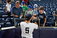 Hudson Valley Renegades shortstop Anthony Volpe (5) signs autographs after a game against the Brooklyn Cyclones on September 12, 2021 at Dutchess Stadium in Fishkill, New York.  (Mike Janes/Four Seam Images)
