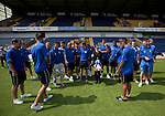 Mansfield Town Football Club Open Day, 14/07/2013. Field Mill stadium, League Two. The first-team squad of Mansfield Town lining up for a team photograph with the Conference National trophy at Field Mill stadium during an open day held for the club's supporters. Mansfield Town achieved promotion back to England's Football League by winning the Conference National in season 2012-13. Field Mill was the oldest ground in the Football League, hosting football since 1861 although some reports date it back as far as 1850, with Mansfield Town having played there since 1919. Photo by Colin McPherson.